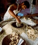 cooking naan bread in a tandoor, Northern India:
