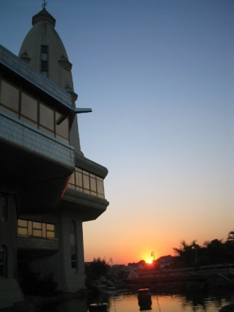 sun rises over moat: